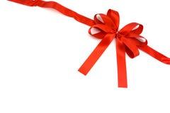 Красная лента с смычком на белой предпосылке Стоковая Фотография RF