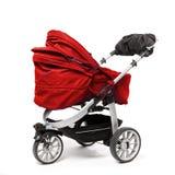 красная детская сидячая коляска на белизне стоковые фотографии rf
