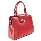 Красная женская лоснистая кожаная сумка изолированная на белой предпосылке Стоковая Фотография RF