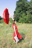 красная женщина зонтика Стоковые Фото