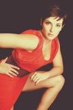Красная женщина платья стоковые изображения