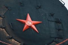 Красная звезда с серпом и молотком символ Советского Союза Стоковая Фотография