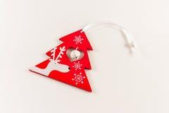 Красная игрушка рождества сформировала с оленями и колоколом Стоковая Фотография