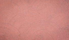 Красная изгибая стена гипсолита для предпосылки текстуры Стоковое Изображение