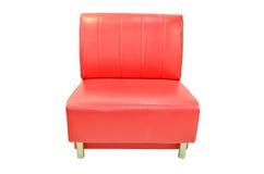 Красная изолированная софа Стоковые Фото