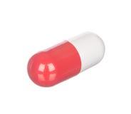 Красная и белая капсула изолированная на белизне Стоковая Фотография