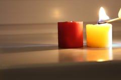 Красная и желтая свечка Стоковое Фото