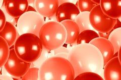 Красная и розовая партия раздувает предпосылка Стоковое фото RF