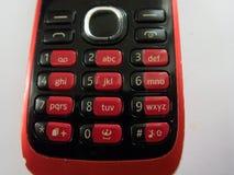 Красная клавиатура старого сотового телефона стоковое изображение rf