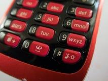 Красная клавиатура старого сотового телефона стоковое фото