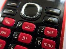 Красная клавиатура старого сотового телефона стоковое фото rf