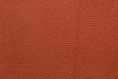 Красная кожаная grained картина предпосылки текстуры Стоковые Фото