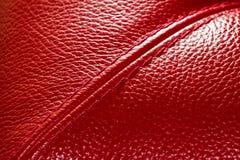 Красная кожа с раскосным швом Стоковые Изображения