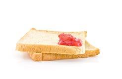 Красная краска варенья на хлебе Стоковые Фото