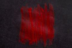 Красная краска на бумаге стоковое фото rf