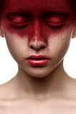 Красная краска на стороне девушки красоты Стоковая Фотография RF