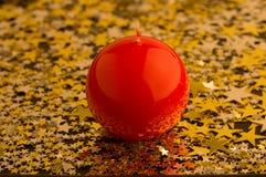 Красная, круглая свечка Стоковая Фотография