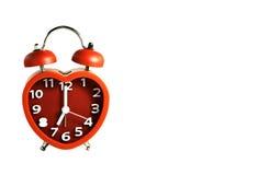 Красная метка звонок с двумя чашками часов на часах ` 7 o Стоковые Изображения