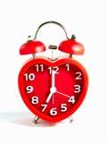 Красная метка звонок с двумя чашками часов на часах ` 7 o Стоковая Фотография RF