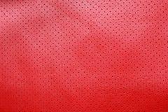 Красная пефорированная кожаная предпосылка текстуры Стоковые Изображения