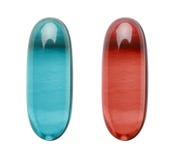 Красная пилюлька сини пилюльки Стоковые Фото