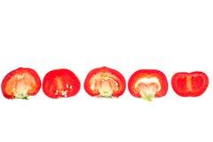 Красная помадка прерванная вокруг перца, изолированного на белой предпосылке Стоковое Фото