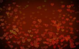 Красная предпосылка конспекта bokeh сердца Стоковые Изображения RF