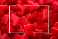 Красная предпосылка сердец с квадратной рамкой на день Святого Валентина стоковые фотографии rf
