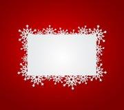 Красная предпосылка рождества с бумажными снежинками. Стоковое фото RF