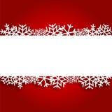 Красная предпосылка рождества с бумажными снежинками Стоковая Фотография RF