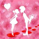 Красная предпосылка с силуэтом мальчика и девушки Стоковые Фото