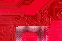 Красная предпосылка текстуры монтажной платы материнской платы компьютера Стоковое фото RF