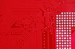 Красная предпосылка текстуры монтажной платы материнской платы компьютера Стоковое Изображение