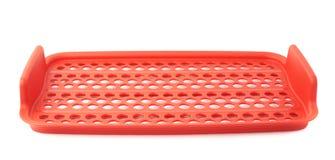 Красная пластичная решетка пищевого контейнера изолированная над белой предпосылкой Стоковое Изображение RF