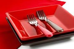 Красная плита и 2 вилки Стоковое Изображение