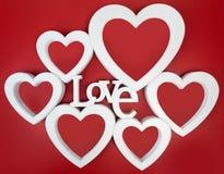 Красная рамка фото сердец, стоя прямо на isolaed белой предпосылке Стоковое Изображение