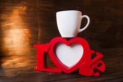 Красная рамка фото с чашкой стоковая фотография