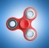 Красная рука Spiner 3d представляет на голубой предпосылке Стоковые Фото