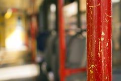 Красная ручка в трамвае стоковое изображение