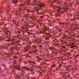 Красная сияющая текстура, sequins с предпосылкой нерезкости Стоковые Фотографии RF