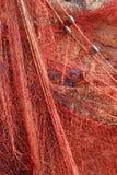Красная смертная казнь через повешение рыболовной сети на стене Стоковое Изображение