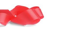 Красная спираль ленты на белой предпосылке стоковое изображение