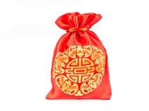 Красная сумка ткани или плен ang с картиной китайского стиля на сером bac Стоковые Изображения RF