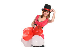 Красная с волосами девушка в розовом шлеме платья и цилиндра стоковые фото