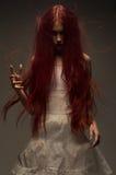 Красная с волосами женщина зомби стоковая фотография rf