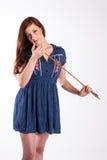 Красная с волосами женщина с стрелкой Стоковое фото RF