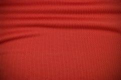 Красная текстура одежды jersey спорта Стоковая Фотография RF