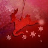 Красная текстура рождества с северным оленем и снежинками Стоковое Изображение