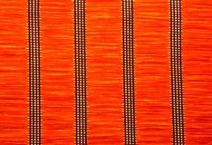Красная текстура циновки соломы с вертикальными картинами Стоковое Фото