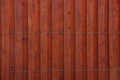 Красная темная предпосылка деревянных доск загородки Стоковые Фото